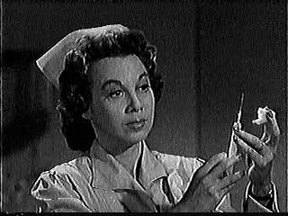 Gloria Blondell as a nurse