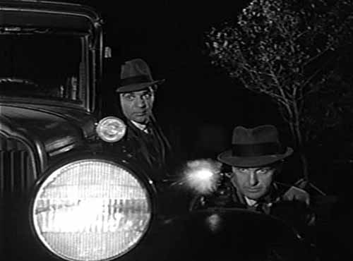 Lee Hobson and Eliot Ness in a gun battle